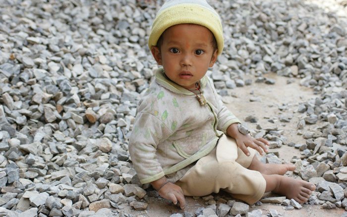 Little boy playing with stones